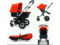 Bugaboo travel system with spare fabrics black and red