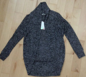 Never worn, Girls Cardigan Grey/black mix. Smoke free home.