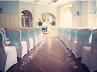 Wedding decor including chair covers, centrepieces, aisle runner, bay tres by Lily Special Events