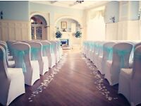 Wedding venue decor by Lily Special Events including chair covers, centrepieces, bay trees