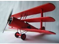 """Red Baron of ww1 tryplane, prop rotates when you press the pilot. wing span14""""made of wood"""