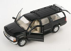BLITZ VERSAND Chevrolet Chevy Suburban 2001 schwarz Welly Modell Auto 1:24 NEU
