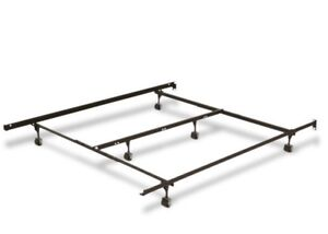 Bed frame with casters and supporting middle bar