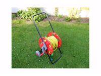 Garden hose with a hose reel.