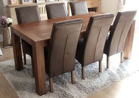 Habufa High Quality Dining table and chairs purchased from Furniture Village