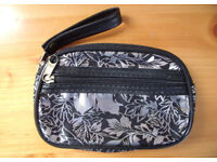 NEW silver metallic black leaf design coin purse. Internal & external zipped pockets. Carry strap.