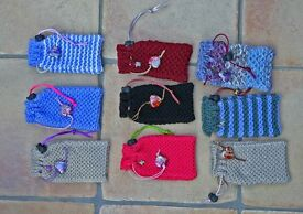 Hand knitted mobile phone covers, top quality with added charms.Job lot for serious sellers only.