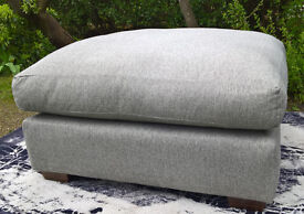 A New Lucas Grey Fabric Material Footstool.