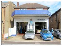 Freehold car repair garage with workshops to the rear and 2 Bed Flat