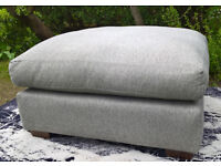 A New Lucas Large Grey Fabric Material Footstool.