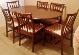 Stag dining table and 6 chairs, extendable with Regency Stripe upholstery - very good condition