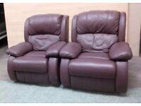 A pair of Italian leather armchairs with leg raise