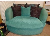 Teal cuddle couch.