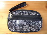 NEW silver metallic black leaf design coin purse. Internal & external zipped pockets. Carry strap.