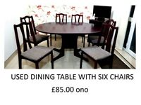 very good condition dining table with six matching chairs