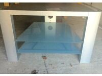 Silver debenhams tv stand with glass shelves
