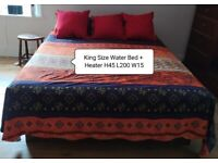ENJOY THE SLEEP OF THE JUST IN A BARELY USED WATER BED