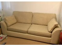 Amazing condition three seater material cream sofa