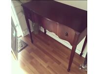 Writing desk with a key