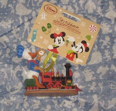 DISNEY STORE ENGINEER DONALD DUCK TRAIN 2016 SKETCHBOOK ORNAMENT. NEW.