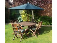 GARDEN TABLE PLUS 6 CHAIRS, CUSHIONS AND PARASOL