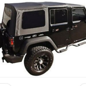Black Jeep Soft top 4 door 2012 only used one summer