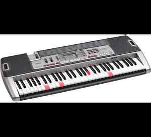 Full size keyboard and Stand -- The Casio LK-210 Keyboard