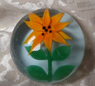 JOE BARKER PAPER WEIGHT ORANGE CLEMATIS ON WHITE BACK GROUND