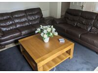 Finlay Teak leather sofas and matching storage pouffe