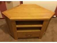 Light wood corner TV unit with a drawer and two shelves