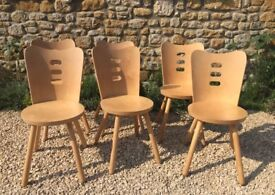 Six stylish wooden dining chairs. Excellent condition.