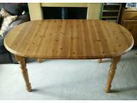 Large pine extendable table and 6 chairs with cushions