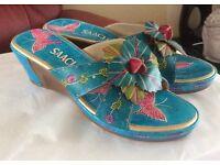 Brand new, never worn, decorative mule wedge sandals