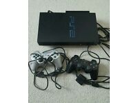 Sony playstation 2 slimline console and 2 controllers