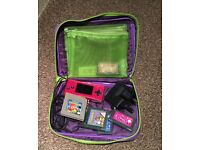Pink Gamebox Micro with games and charger.