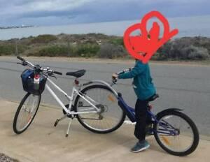 Tag along bike attachment