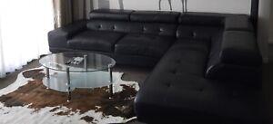 Black leather corner lounge for free