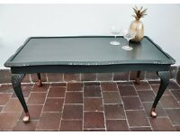 Painted coffee table. Black with copper socks and copper highlights.
