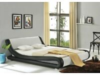 no longer required, unused designer faux leather bed!
