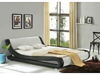 King size black and white faux leather bed