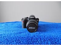 Nikon D3100 DSLR Camera with lens for sale