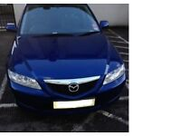 Blue Mazda good condition for age low mileage