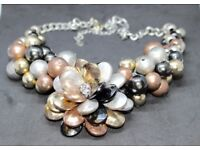 Stunning, elaborate, floral-styled, beaded necklace. Matching bracelet avail. Will fit most wrists