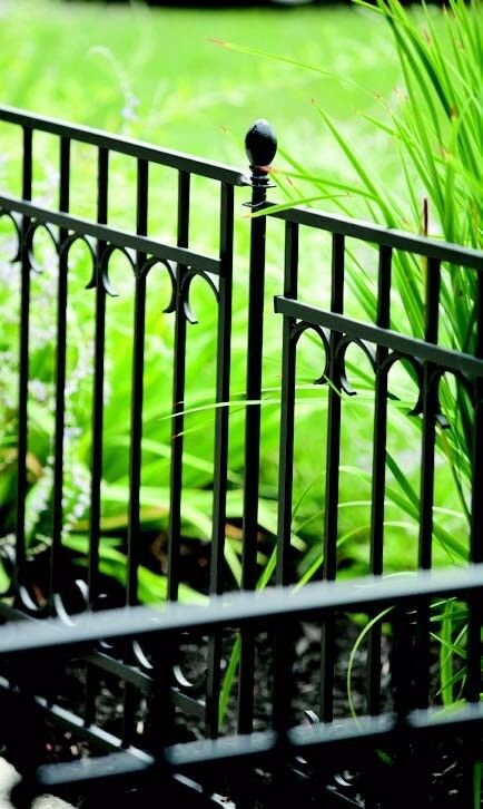 Black metal sectional fencing with fence post