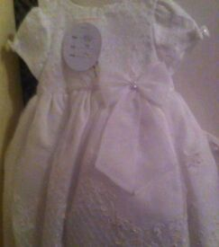 Brand new gown with tags and protection bag all still on never worn
