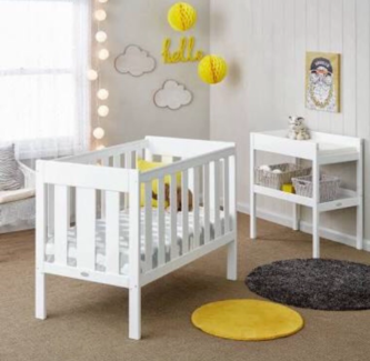 White cot and change table