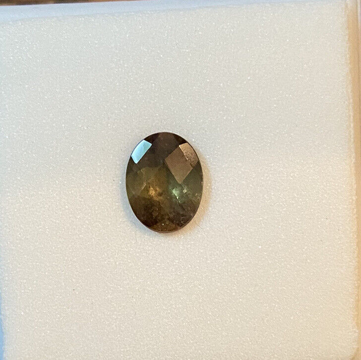 andalusite 9x7mm oval 1.50ct checkerboard cut