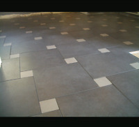 Phone QUALITY TILING today at 226 -975-4405