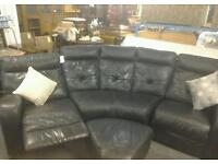 Black leather curved sofa with reclining seats and footstool (24266)