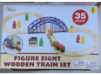 Brand new boxed figure if 8 wooden track train set!